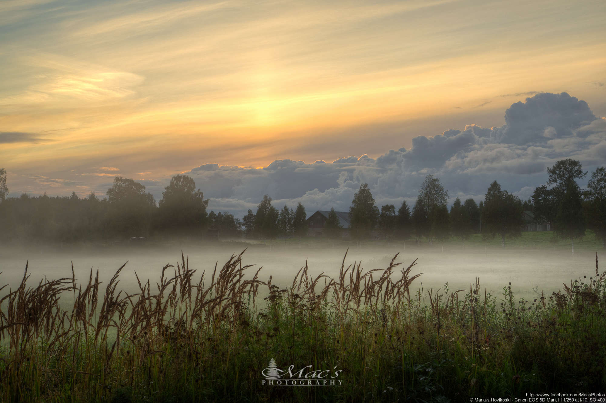 Beautiful Finnish countryside landscape with sunset and fog